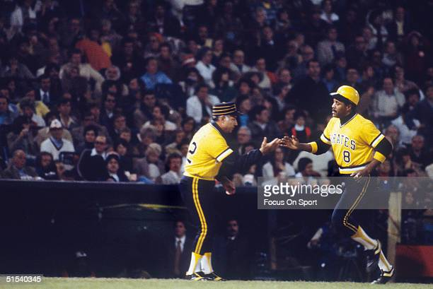 Willie Stargell of the Pittsburgh Pirates rounds third base after his sixth inning home run in Game Seven during the World Series against the...