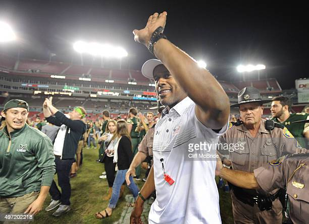 Willie Taggart head coach for South Florida Bulls celebrates on the field after the game against the Temple Owls at Raymond James Stadium on November...