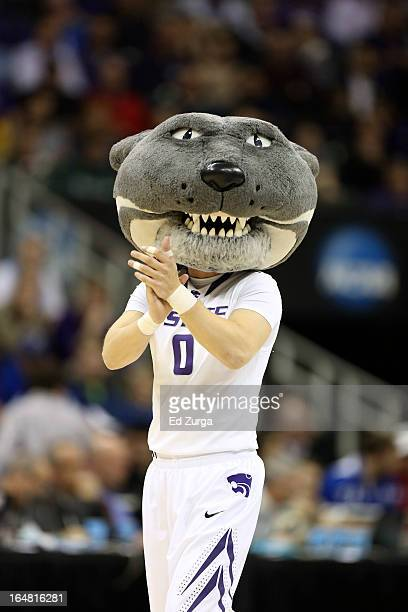 Willie the Wildcat the Kansas State Wildcats mascot performs during the second round of the 2013 NCAA Men's Basketball Tournament at the Sprint...