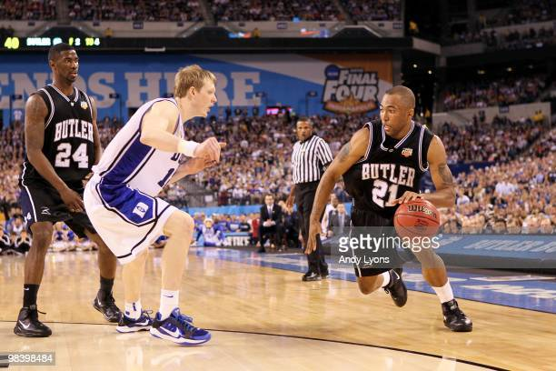 Willie Veasley of the Butler Bulldogs drives against Kyle Singler of the Duke Blue Devils during the 2010 NCAA Division I Men's Basketball National...