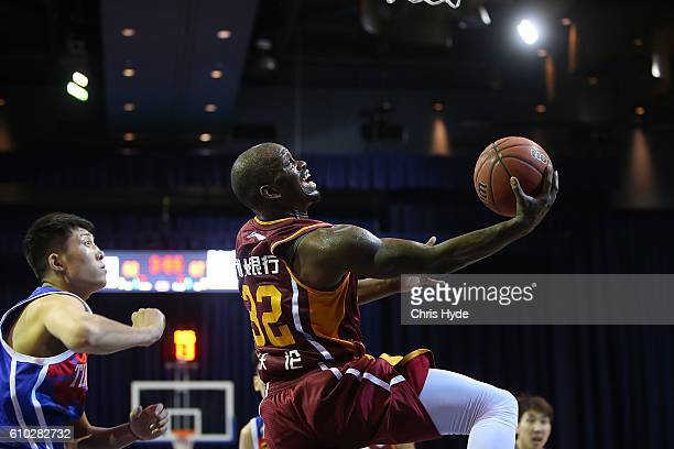 Willie Warren of the Golden Bulls shoots during the Australian Basketball Challenge match between Tianjin Ronggang Gold Lions and Zhejiang Golden...