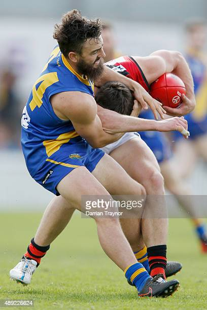Willie Wheeler of Williamstown tackles Joshua Freezer of Essendon during the VFL Preliminary Final match between Williamstown and Essendon at North...