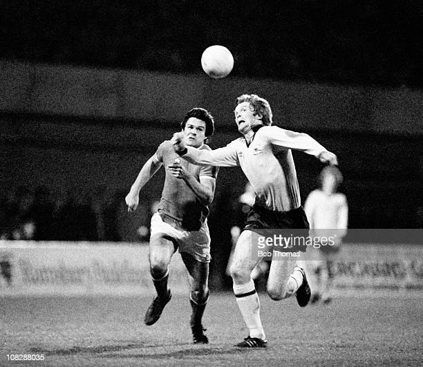 Willie Young of Arsenal with Andy Rowland of Swindon Town during the Swindon Town v Arsenal League Cup 5th Round Replay match played at the County...