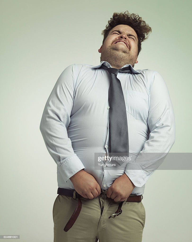 Willing his pants closed : Stock Photo
