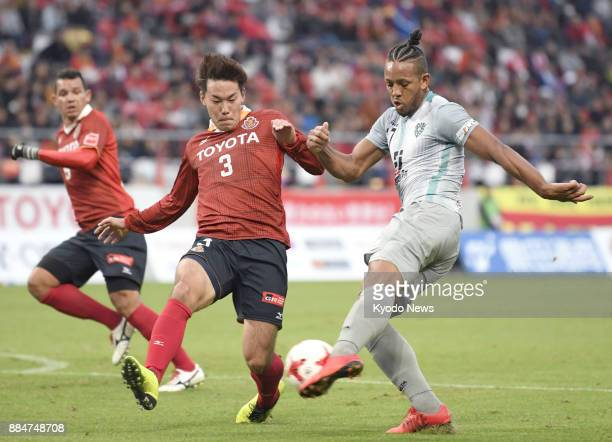 Willington of Avispa Fukuoka shoots as Kazuki Kushibiki of Nagoya Grampus rushes to block in the first half of a 00 draw in the JLeague second...