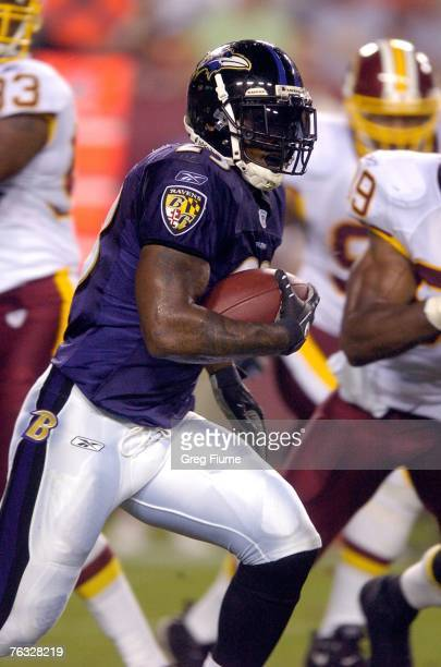 Willis McGahee of the Baltimore Ravens rushes the ball against the Washington Redskins in a preseason NFL game August 25, 2007 at FedEx Field in...