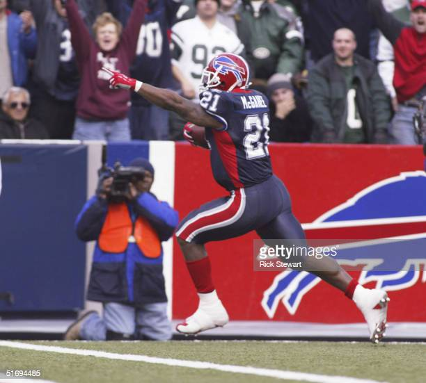 Willis McGahee of the Buffalo Bills scores the Bills first touchdown against the New York Jets on November 7 2004 at Ralph Wilson Stadium in Orchard...