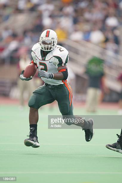 Willis McGahee of the Miami Hurricanes rushes against the Temple Owls during their game on September 14, 2002 at Franklin Field in Philadelphia,...