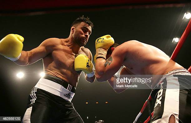 Willis Meehan fights Rhys Sullivan during their heavyweight bout during the Footy Show Fight Night at Allphones Arena on January 31, 2015 in Sydney,...