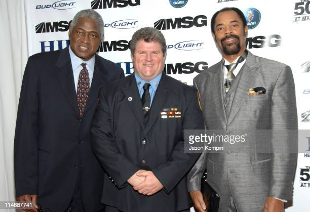 Willis Reed, FDNY Firefighter Michael Moran and Walt Frazier