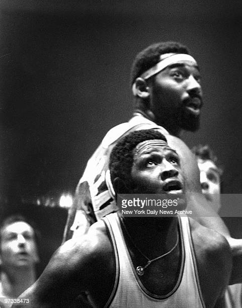 Willis Reed of the Knicks and Wilt Chamberlain of the Lakers as time runs out in game at Madison Square Garden