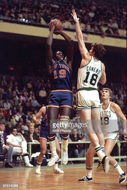 Willis Reed of the New York Knicks shoots over Dave Cowens of the Boston Celtics during an NBA game