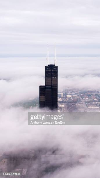 willis tower during against cloudy sky foggy weather - willis tower stock photos and pictures