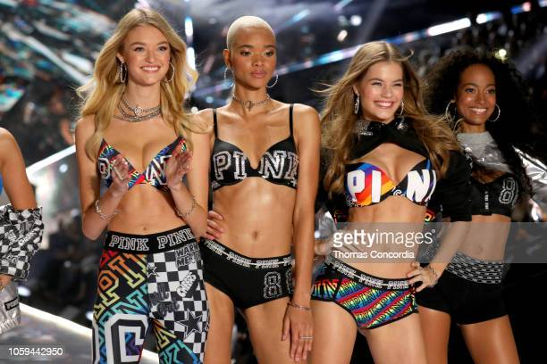 Willow Hand Iesha Hodges Myrthe Bolt and Melie Tiacoh walk the runway in the 2018 Victoria's Secret Fashion Show at Pier 94 on November 8 2018 in New...