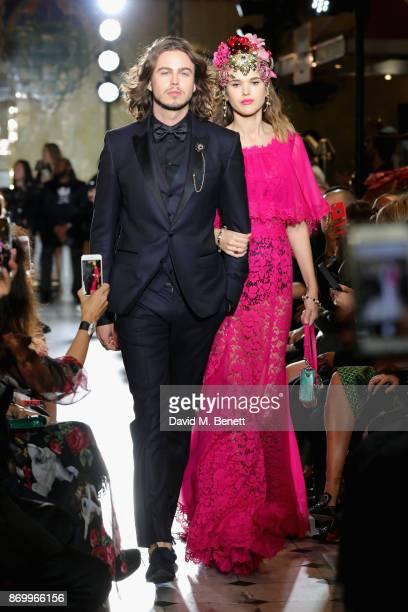 Willow Robinson and Frankie Herbert walk the Dolce Gabbana Italian Christmas catwalk show at Harrods on November 2 2017 in London England