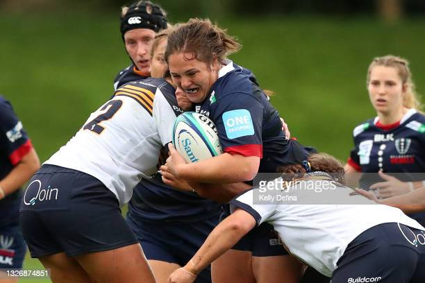 Willow Rowland of the Rebels runs with the ball while being tackled during the Super W match between the Melbourne Rebels and the ACT Brumbies at...