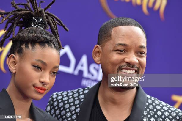 Willow Smith and Will Smith attend the premiere of Disney's Aladdin on May 21 2019 in Los Angeles California