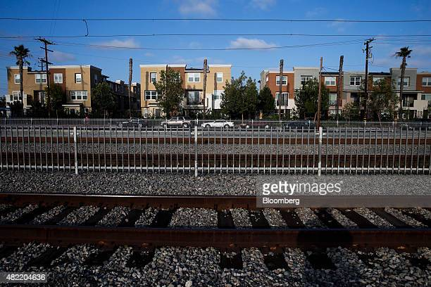 Willow Walk Condos and Townhomes stand past Metro Blue Line light rail tracks in Compton California US on Monday July 6 2015 It can be a letdown for...