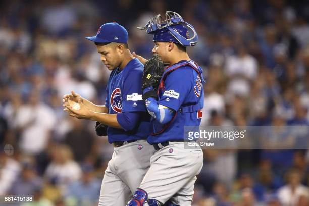 Willson Contreras and Jose Quintana of the Chicago Cubs talk on the mound in the fifth inning during Game One of the National League Championship...