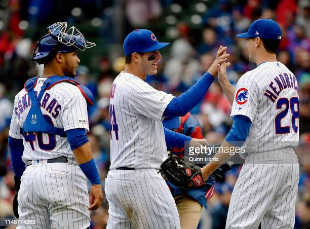 Willson Contreras Anthony Rizzo and Kyle Hendricks of the Chicago Cubs celebrate the 40 win against the St Louis Cardinals at Wrigley Field on May 03...