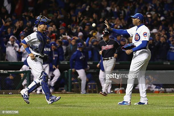 Willson Contreras of the Chicago Cubs and Aroldis Chapman celebrate after beating the Cleveland Indians 3-2 in Game Five of the 2016 World Series at...