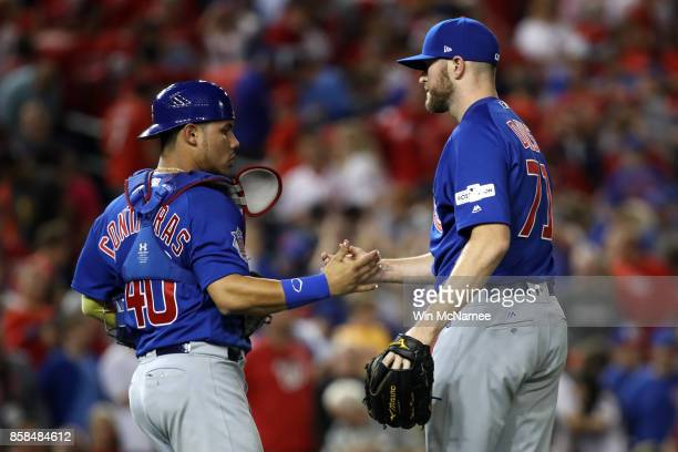 Willson Contreras of the Chicago Cubs and Wade Davis of the Chicago Cubs after defeating the Washington Nationals in game one of the National League...