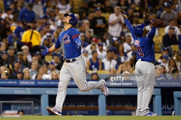 Willson Contreras of the Chicago Cubs and Willie Harris of the Chicago Cubs react as Contreras rounds third base after hitting a two run home run...