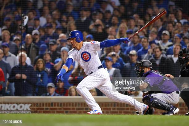 Willson Contreras of the Chicago Cubs bats during the 11th inning in the National League Wild Card game against the Colorado Rockies at Wrigley Field...