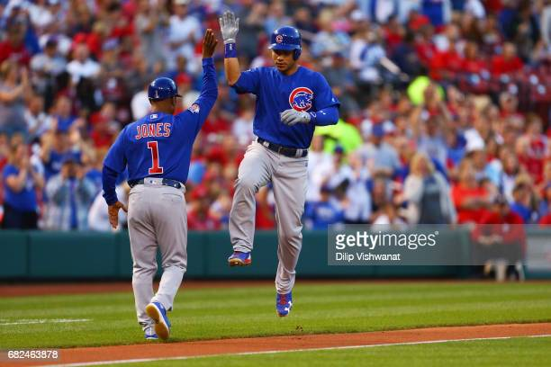 Willson Contreras of the Chicago Cubs celebrates after hitting a solo home run against the St Louis Cardinals in the second inning at Busch Stadium...