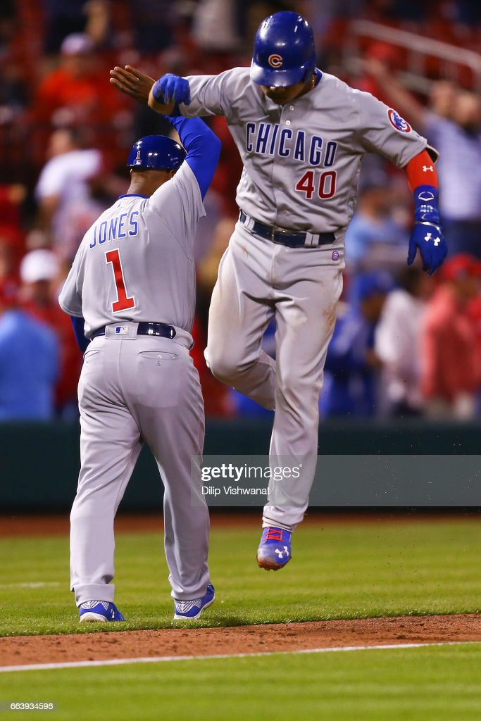 Willson Contreras #40 of the Chicago Cubs celebrates after hitting game-tying three-run home run against the St. Louis Cardinals in the ninth inning during the 2017 MLB Opening Day at Busch Stadium on April 2, 2017 in St. Louis, Missouri.