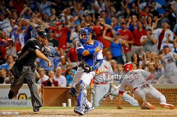 Willson Contreras of the Chicago Cubs celebrates after home plate umpire Pat Hoberg called out Aledmys Diaz of the St Louis Cardinals during the...