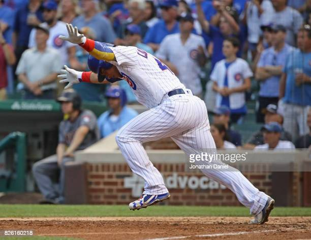 Willson Contreras of the Chicago Cubs celebrates as he runs to first base after hitting a two run single in the 7th inning against the Arizona...