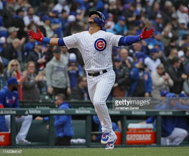 Willson Contreras of the Chicago Cubs celebrates hitting a home run in the 1st inning as he runs the bases against the Los Angeles Angels at Wrigley...
