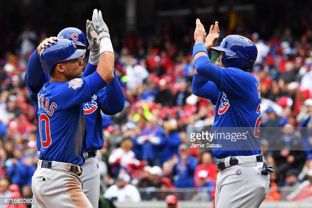 Willson Contreras of the Chicago Cubs celebrates with Addison Russell of the Chicago Cubs after hitting a grandslam home run in the second inning...