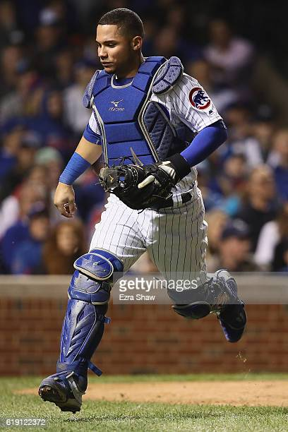 Willson Contreras of the Chicago Cubs chases after a wild pitch in the seventh inning against the Cleveland Indians in Game Four of the 2016 World...