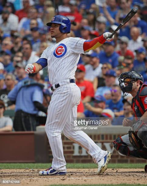 Willson Contreras of the Chicago Cubs follows the flight of his two run home run in the 6th inning against the Washington Nationals at Wrigley Field...