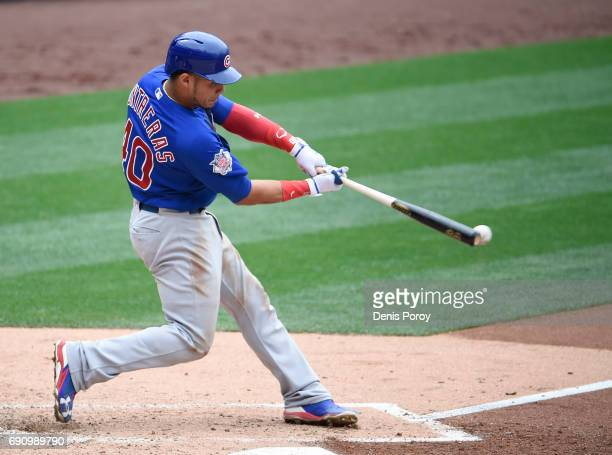 Willson Contreras of the Chicago Cubs hits a double during the fifth inning of a baseball game against the San Diego Padres at PETCO Park on May 31...