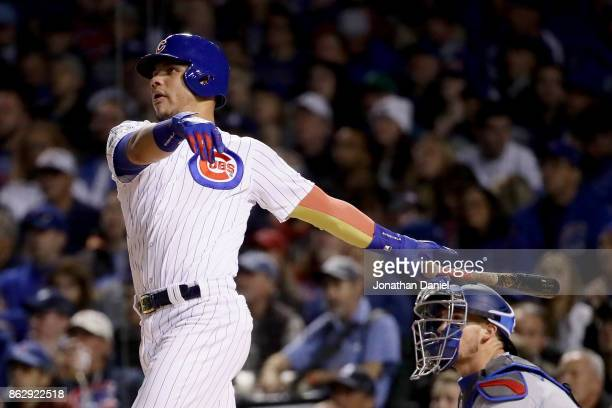 Willson Contreras of the Chicago Cubs hits a home run in the second inning against the Los Angeles Dodgers during game four of the National League...