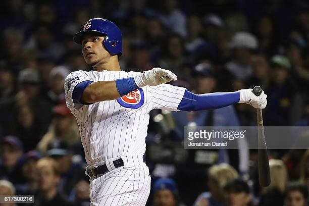 Willson Contreras of the Chicago Cubs hits a solo home run in the fourth inning against the Los Angeles Dodgers during game six of the National...