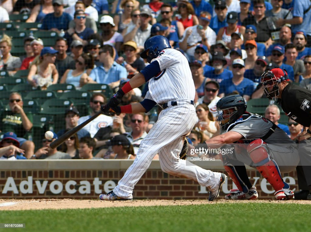 Willson Contreras #40 of the Chicago Cubs hits a two-RBI double against the Detroit Tigers during the seventh inning on July 4, 2018 at Wrigley Field in Chicago, Illinois.