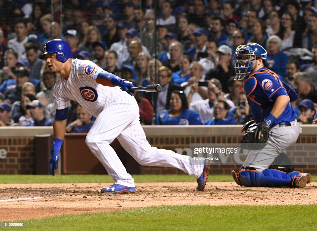 Willson Contreras #40 of the Chicago Cubs hits a two-RBI single against the New York Mets during the fourth inning on September 13, 2017 at Wrigley Field in Chicago, Illinois.