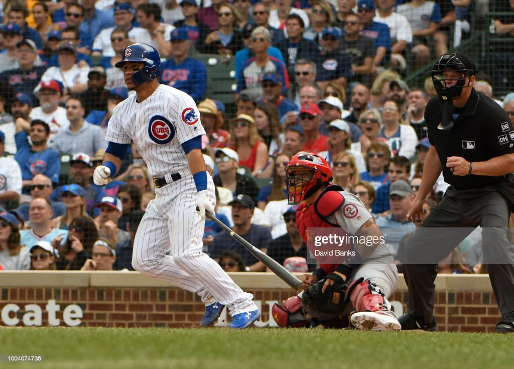 Willson Contreras #40 of the Chicago Cubs hits an RBI single against the St. Louis Cardinals during the eighth inning on July 22, 2018 at Wrigley Field in Chicago, Illinois.