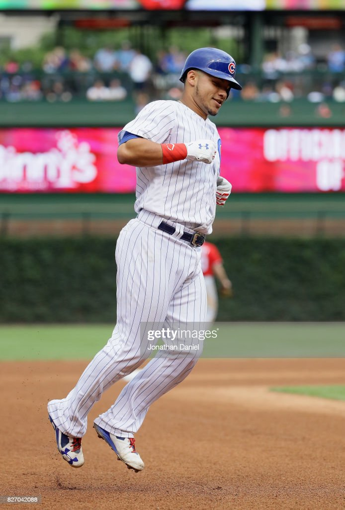 Willson Contreras #40 of the Chicago Cubs hops as he runs the bases after hitting his second home run of the game, a solol shot in the 6th inning, against the Washington Nationals at Wrigley Field on August 6, 2017 in Chicago, Illinois.