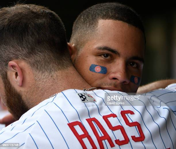 Willson Contreras of the Chicago Cubs hugs Anthony Bass of the Chicago Cubs on July 4 2018 at Wrigley Field in Chicago Illinois The Cubs won 52