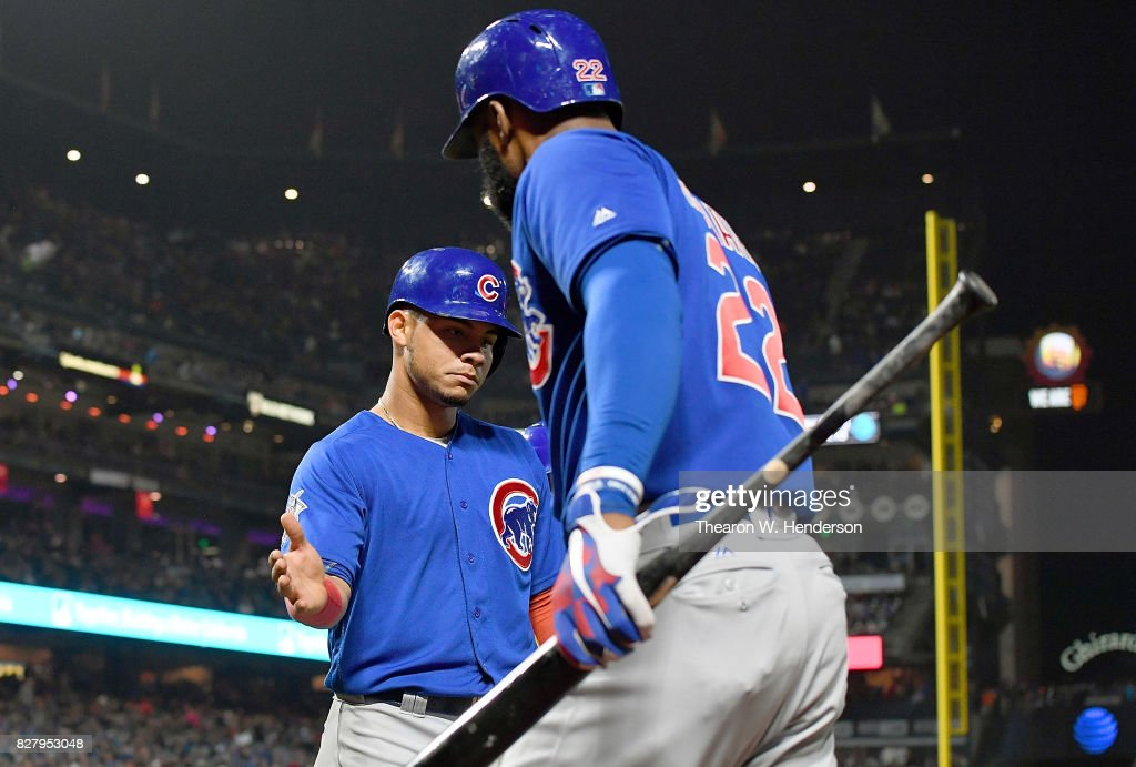 Willson Contreras #40 of the Chicago Cubs in scongratulated by Jason Heyward #22 after Contreras scord against the San Francisco Giants in the top of the six inning at AT&T Park on August 8, 2017 in San Francisco, California.
