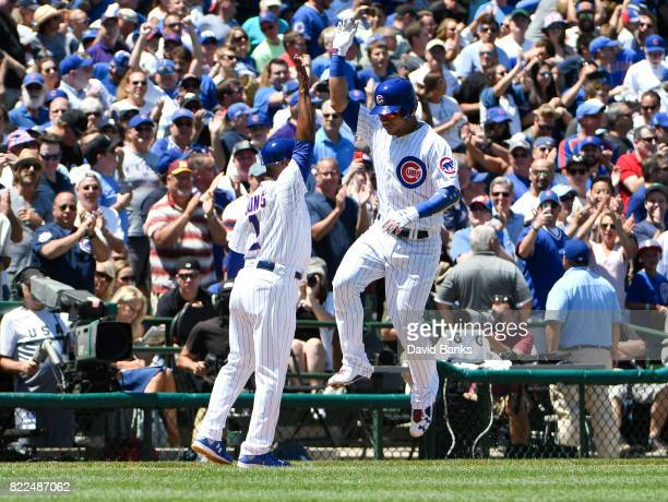 Willson Contreras of the Chicago Cubs is greeted by Gary Jones after hitting threerun homer against the Chicago White Sox during the first inning on...