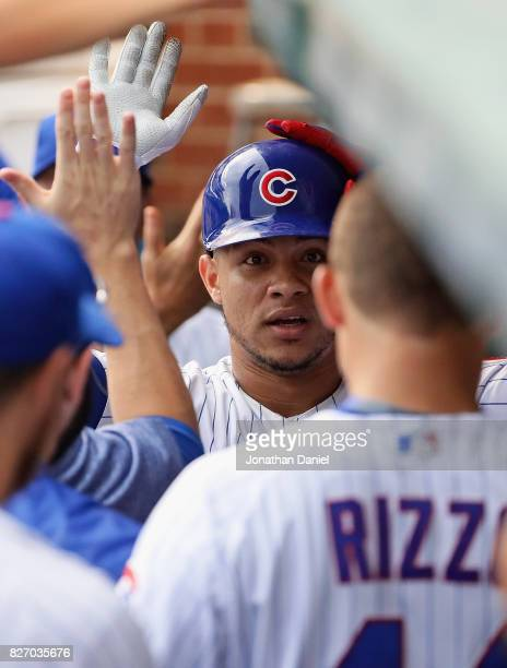 Willson Contreras of the Chicago Cubs is greeted by teammates in the dugut after hitting a solo home run in the 3rd inning against the Washington...