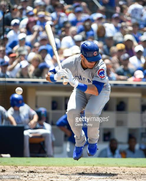 Willson Contreras of the Chicago Cubs is hit with a pitch during the third inning of a baseball game against the San Diego Padres at PETCO Park on...