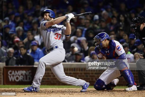 Willson Contreras of the Chicago Cubs is struck by a pitch as Charlie Culberson of the Los Angeles Dodgers strikes out in the eighth inning during...