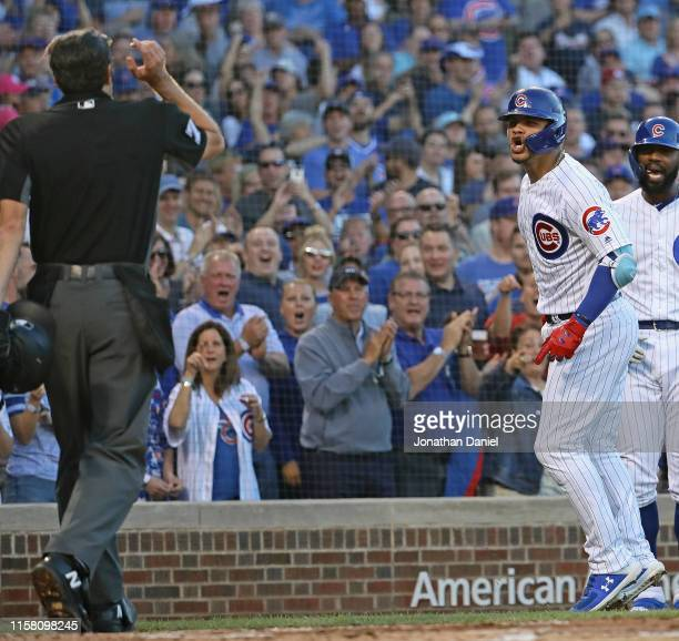 Willson Contreras of the Chicago Cubs is warned to go to the dugout by home plate umpire John Tumpane after hitting a solo home run in the 2nd inning...